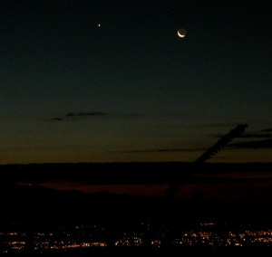 up-early strategy for resilience yields this unique view of almost-new-moon, Venus close by, and just above the red dot of light on the mountain is Mercury, usually too close to the sun to see.